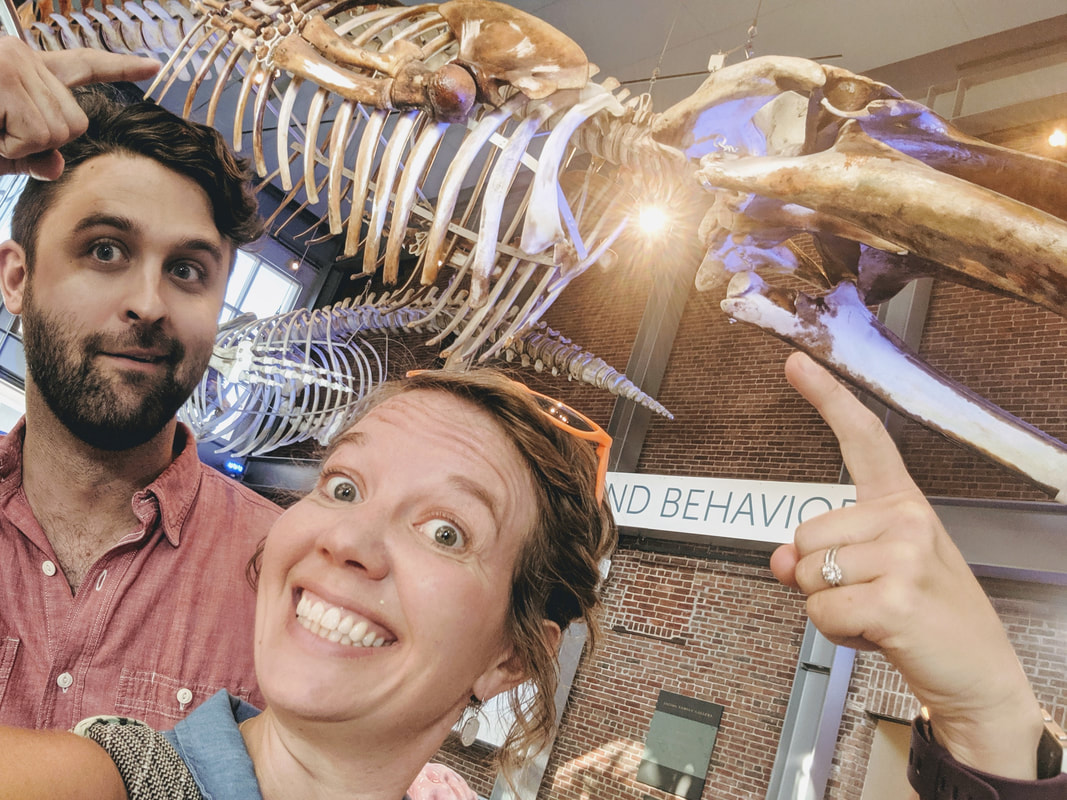Wyatt Kent and Jill Stuck pose with a whale's skeleton at the Whaling Museum in New Bedford, MA (Twenty Questions with Wyatt Kent, Compass Creative Dramatics Artistic Director)
